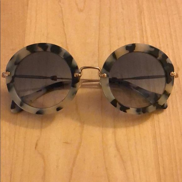 15c4a460a650 Miu Miu Retro Round Gray Tortoiseshell Sunglasses.  M 5a4aba20caab44470305e2da. Other Accessories ...